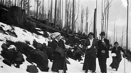 Photograph of a group of young people throwing snowballs in about 1918.
