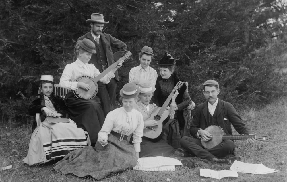 Men and women playing banjos and a guitar, c.1893